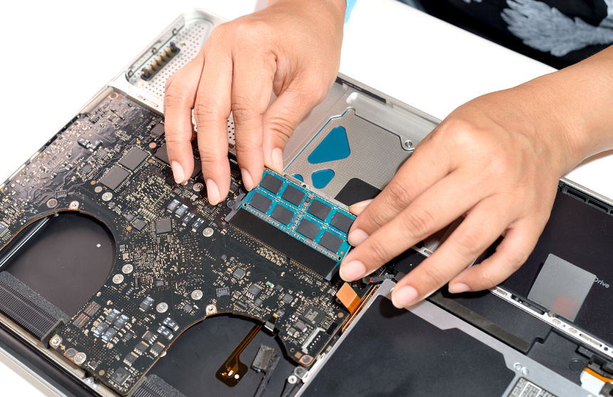66466805 - technician install upgrade memory for laptop computer